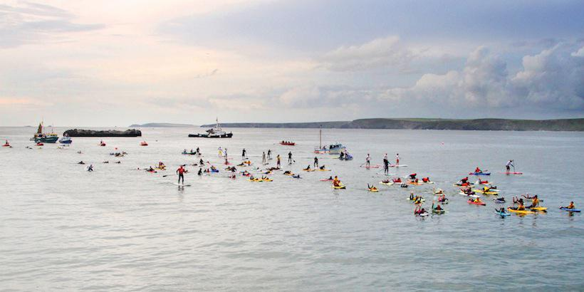 19 Nowhereisland greeted by Newquay flotilla Photo Matt Bunt