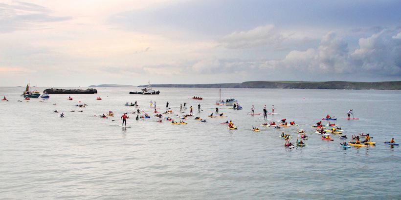 19 Nowhereisland greeted by Newquay flotilla Photo Matt Bunt