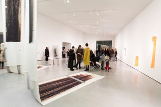 Alice Channer in conversation with The Hepworth Wakefield Curator Gemma Yates (centre) in her exhibition space