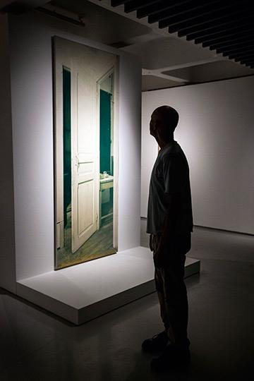 12 Visitor looks at the work Door 11, rue Larrey (replica) (1964) by Marcel Duchamp Photo Felix Clay 2013