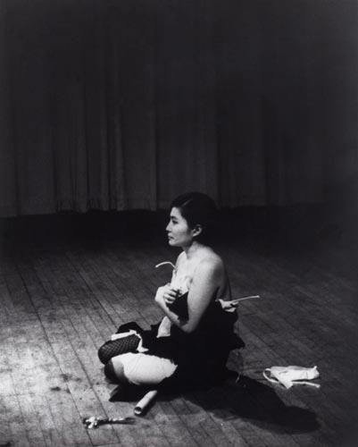 Cut Piece, 1965 Performed by Yoko Ono Carnegie Recital Hall, New York, March 21, 1965 Photo by Minoru Niizuma Courtesy of Yoko Ono