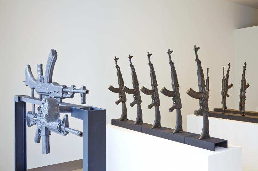 Installation view with AK-47/AR-15 and AK-47