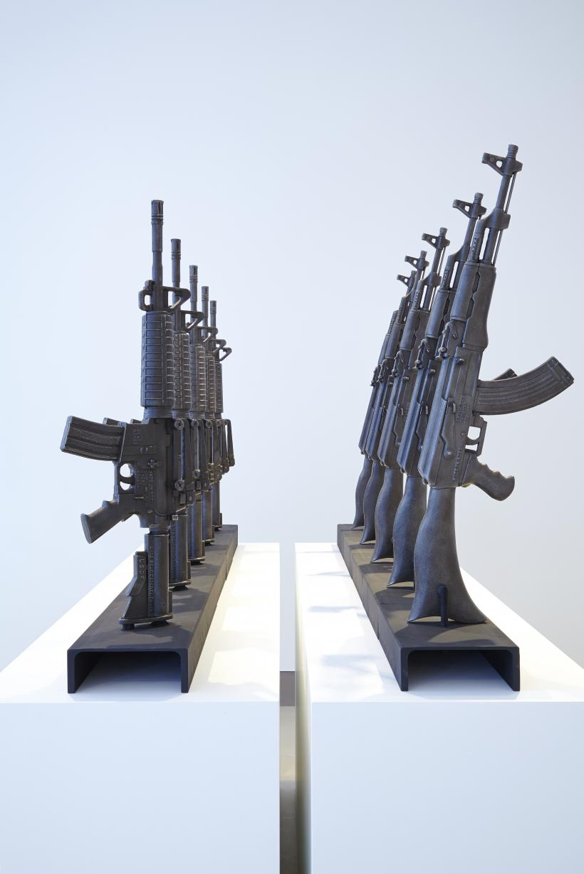 installation view with AR-15 and AK-47