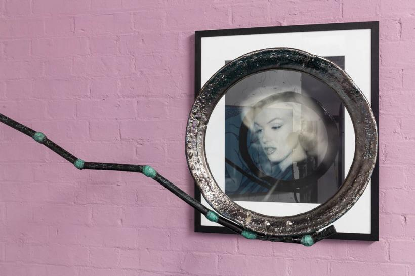 Than Hussein Clark, Cancellation Lens, 2015 (courtesy Mathew Gallery, Berlin) and Andre de Diesnes, Marilyn in a Bookshop, c. late 1940s (David Roberts Collection, London) in the VIP Lounge in The Violet Crab at DRAF, 2015