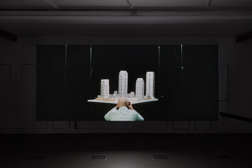 Amie Siegel, The Architects, 2014 HD video, color, sound. Installation view, Storefront for Art and Architecture, New York, 2015