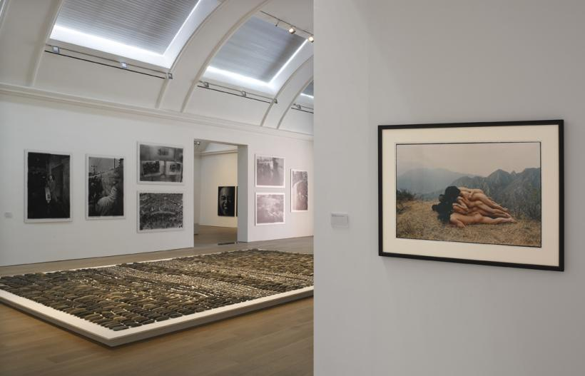 The M+ Sigg Collection: Chinese Art from the 1970s to Now, The Whitworth, Manchester. Foreground: To Add one Meter to an Anonymous Mountain (1995) by Zhang Huan