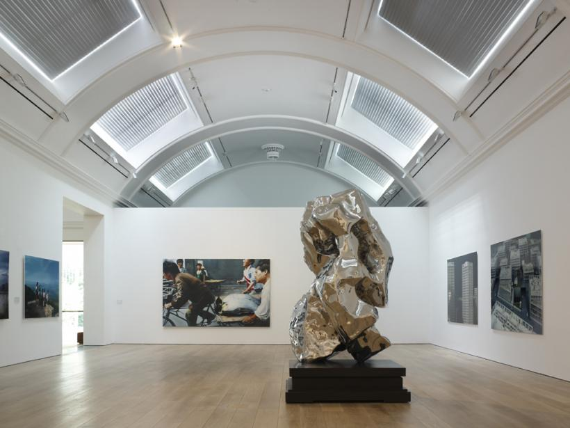 The M+ Sigg Collection: Chinese Art from the 1970s to Now, The Whitworth, Manchester. Background: New Beijing (2001) by Wang Xingwei. Foreground: Artificial Rock No.31 (2001) by Zhan Wang
