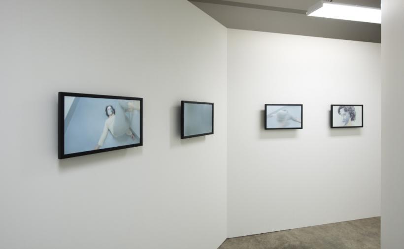 Sarah Anne Johnson, Hospital Hallway, 2015, Video installation; 15 flat screens, octagon shaped hallway, florescent lights, 609.6 x 609.6 x 274.32 cm