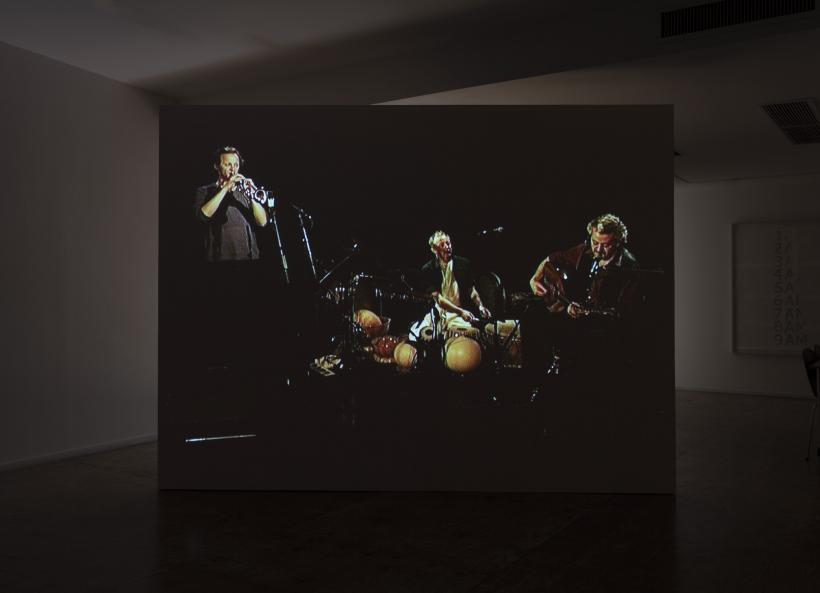 Emily Jacir, ENTRY DENIED (a concert in Jerusalem), 2003, single-channel video (105 minutes), sound, and free-standing wall