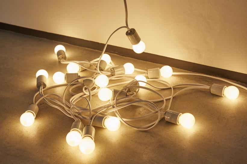 "Felix Gonzalez-Torres, ""Untitled"" (Rossmore), 1992 [detail], Light bulbs, porcelain light sockets, and extension cords  Installation view at the MAC, Belfast"
