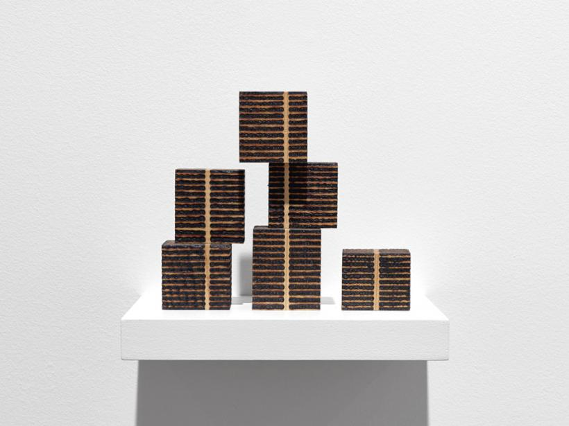 Roger Ackling, 6 Unit Stack Piece, Voewood, 1999, sunlight on wood, 6 parts, 11 x 12.5 x 3.5cm overall