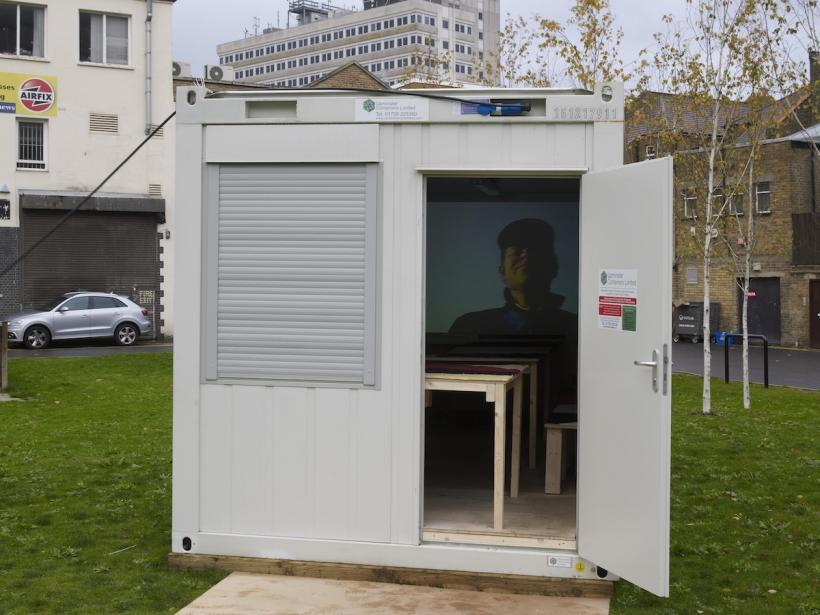 Erik van Lieshout, Rotterdam – Rostock, 2006 DV transferred to DVD (17 minutes) Shipping container, wood, carpet