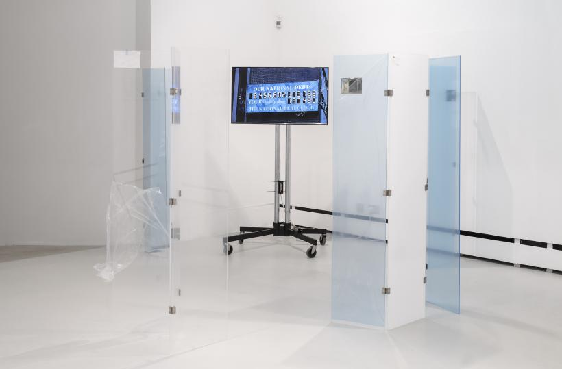 "Yuri Pattison, overflow study, 2016. HD video shot for the artist by Hideki Shiota New York 01/01/16, found images, monitor & stand, perspex, minilab prints of found images, protective film, key, 1:200 scale people, ""Debtman"""