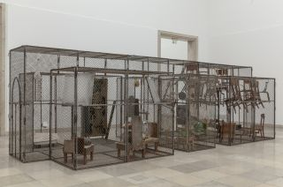 Louise Bourgeois, Passage Dangereux, 1997, Metal, wood, tapestry, rubber, marble, steel, glass, bronze, bones, flax and mirrors, 264.2 x 355.6 x 876.3 cm