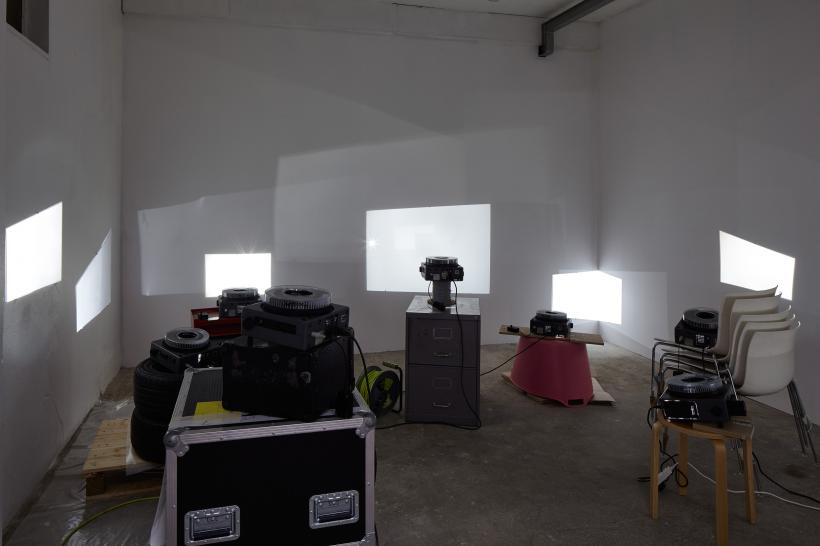 Luis Camnitzer, Art History Lesson no. 6, 2000. Ten slide projectors with various stands, overall dimensions variable.  Installation view: Under the Same Sun: Art from Latin America Today, South London Gallery, June 10-September 4, 2016.