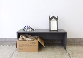 Composition with bench, flowers and mirror, wooden bench, Harry Potter Mirror of Erised cast-iron replica, recycled cardboard box, polystyrene, flowers, 2016