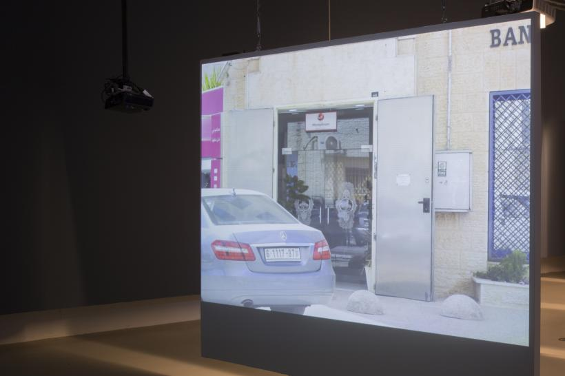 Yazan Khalili, Robbery in Area A, Installation  with two carousel projectors and one video projector, 2013/2016