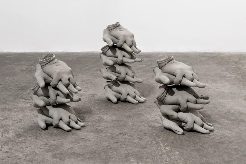 Minimum, Necessary, Objectively Reasonable #1, 2015, Stacks of life-size hands in a CPR position, concrete composite, Dimensions variable.