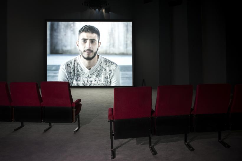 "Bouchra Khalili, The Tempest Society, 2017, digital video, installation view, Athens School of Fine Arts (ASFA)—Pireos Street (""Nikos Kessanlis"" Exhibition Hall), documenta 14"