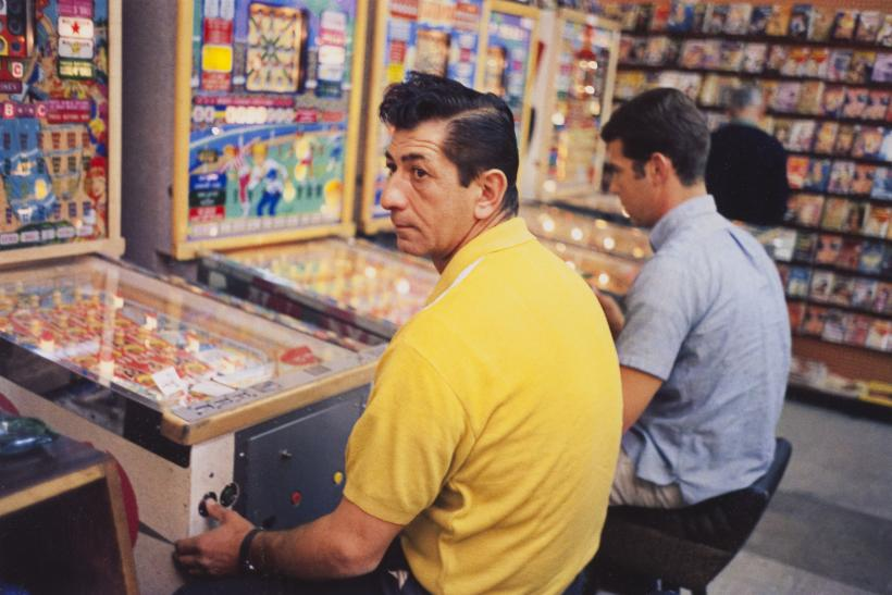 William Eggleston, Las Vegas, (yellow shirt guy at pinball machine), 1965-68, dye-transfer print.