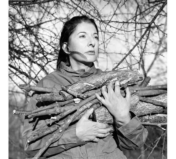 Marina Abramovic. Portrait with Firewood. 2009. Image courtesy the artist, Marco Anelli, and Lisson Gallery