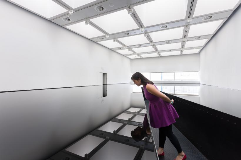 Installation view of Richard Wilson, 20:50, (1987) at Space Shifters