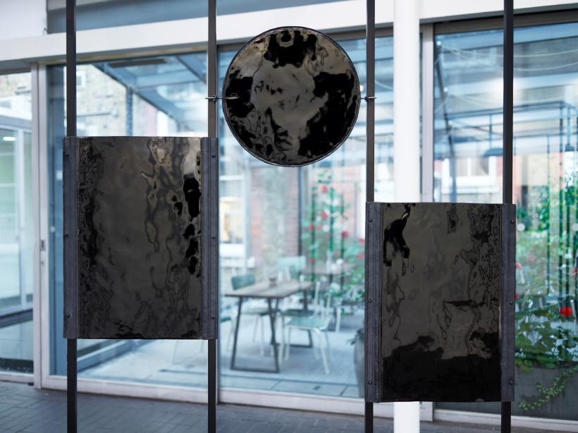 Tana West, Through a Glass Darkly, 2019 (detail). Black glazed ceramics and steel frame.