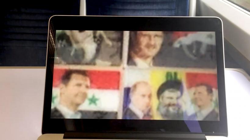 ZouZou Group, Assad, Putin and Nasrallah as market ephemera, on the Dover train, still from – door open –, 2019