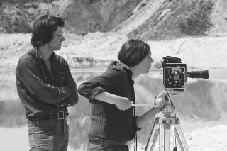 Nancy Holt and Robert Smithson shooting film at the site of Smithson's earthwork Broken Circle/Spiral Hill, Emmen, The Netherlands (1971)