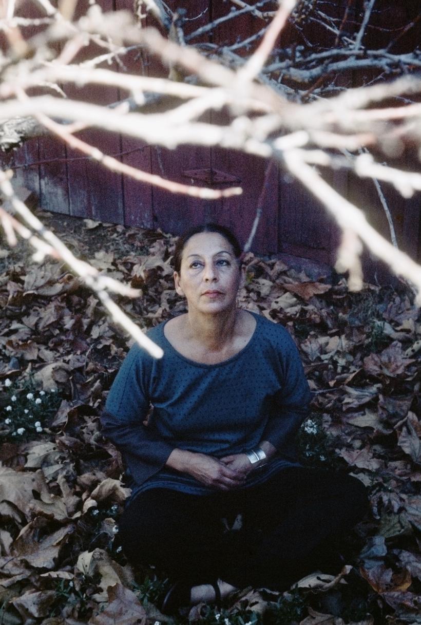 Hurtado meditating under trees behind her Santa Monica Canyon studio, California, 1977.