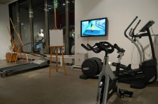 1 three Technogym machines and easels with motion based digital work by David Barnett