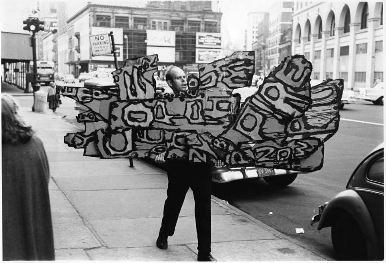 12 Claes Oldenburg carrying Street Sign 1960
